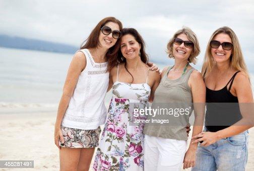 Happy women on beach
