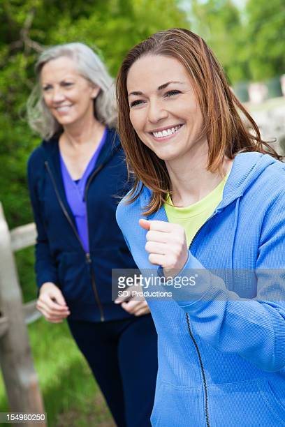 Happy Women Power Walking in a Park