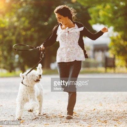Happy women running with dog