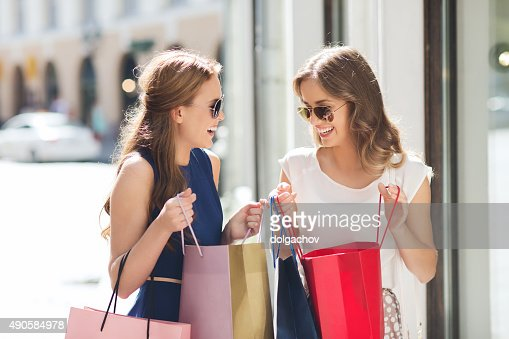 happy women with shopping bags in city : Stock Photo