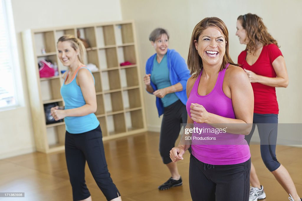 Happy women working out together in fitness exercise class : Stock Photo