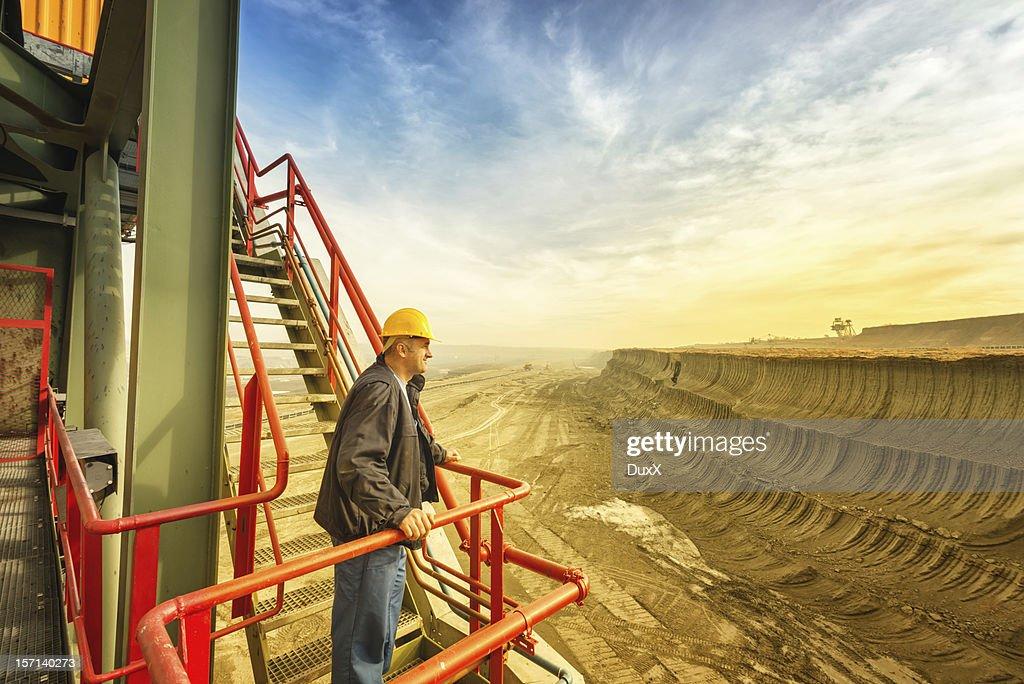 Happy worker on drill machine