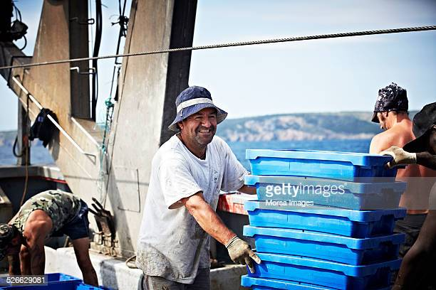 Happy worker on fishing trawler