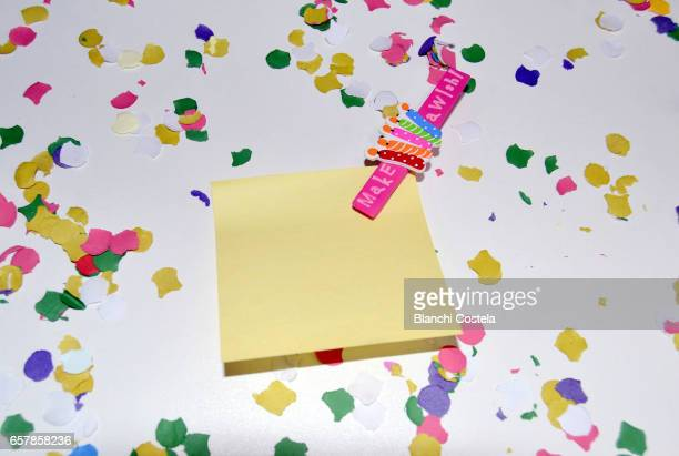 Happy yellow Post-it note and colorful confetti