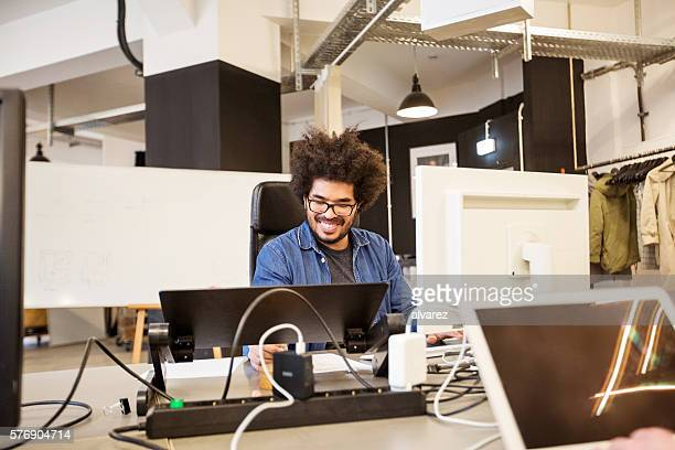 Happy young african male designer working
