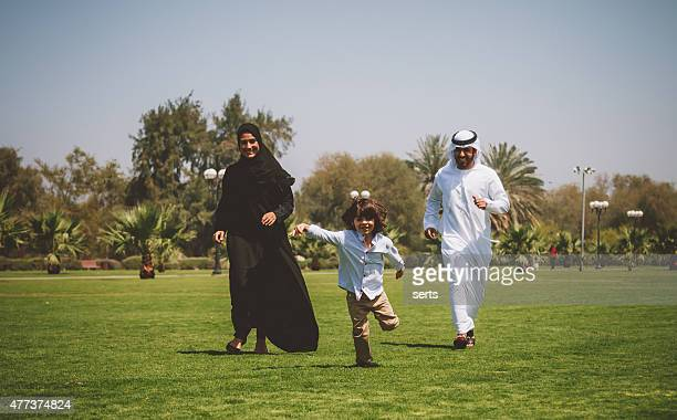 Happy Young Arabic family having fun outdoors at sunny day