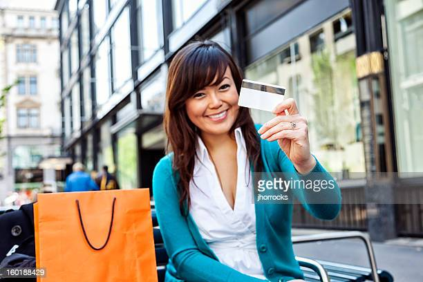 Happy Young Asian Woman with Credit Card