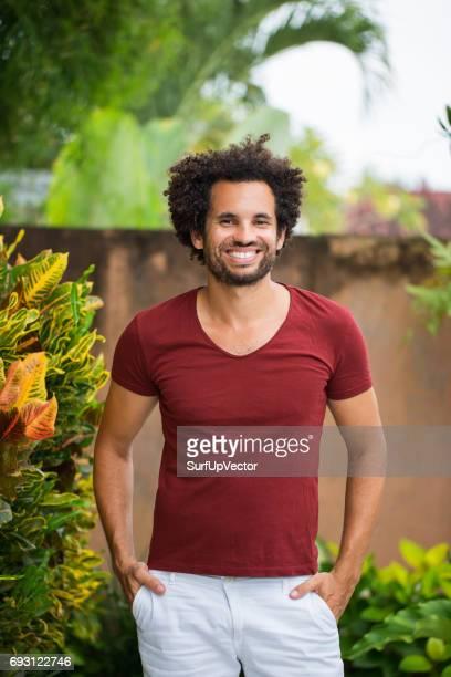 Happy Young Attractive Hispanic Man on Patio