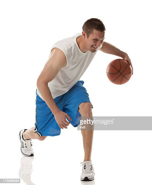 Happy young basketball player in action