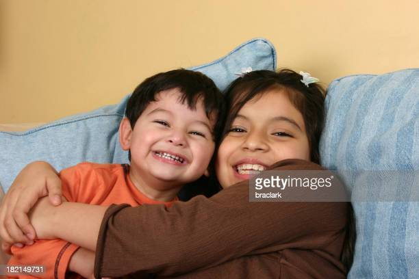 A happy young boy and girl hugging