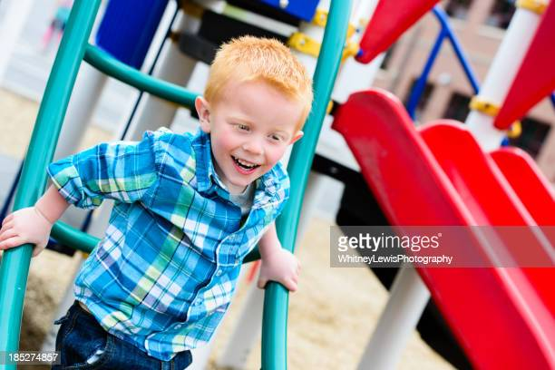 Happy young boy having fun at the playground