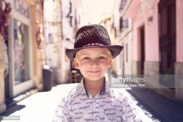 A happy young boy in a Spanish street
