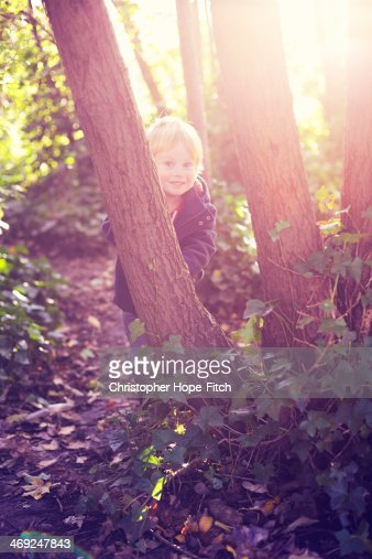 Happy young boy in woodland : Stock Photo