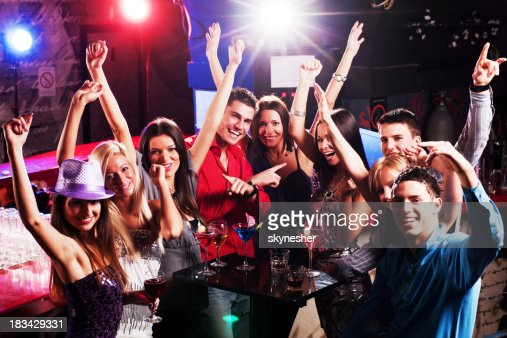 Happy young boys and girls enjoying at a disco. : Stock Photo