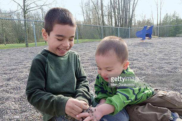 Happy young brothers playing