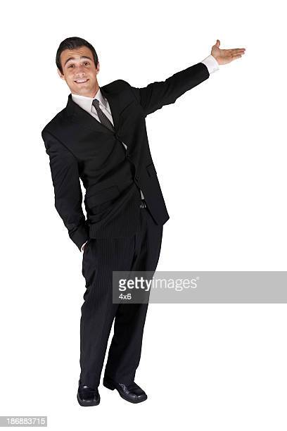Happy young businessman presenting
