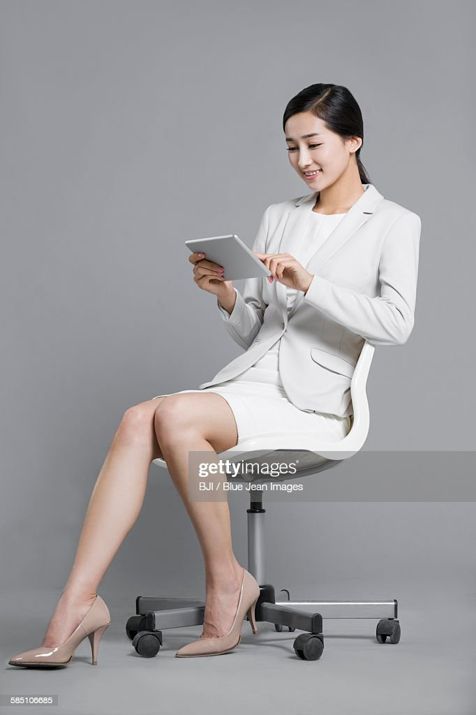 Happy young businesswoman using digital tablet : Stock Photo