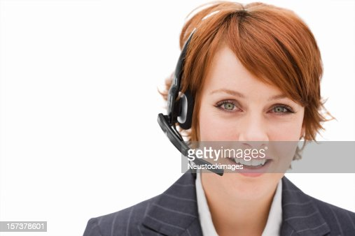 Happy young businesswoman with headset isolated over white background