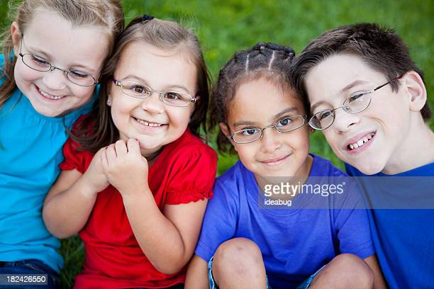 Happy Young Children with Glasses Smiling Outside