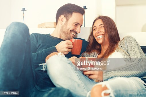 Happy young couple at home : Stock Photo