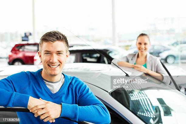 Happy Young Couple By New Car
