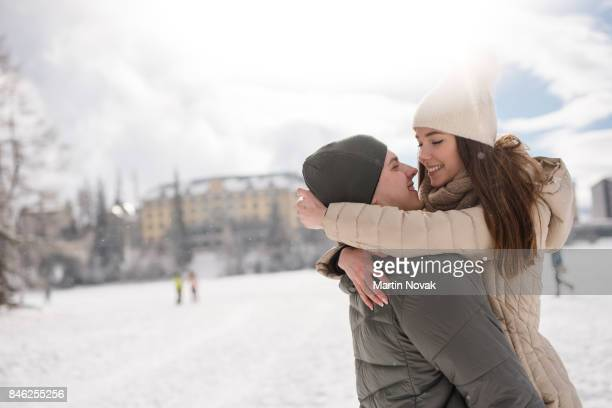 Happy young couple embrace outdoors
