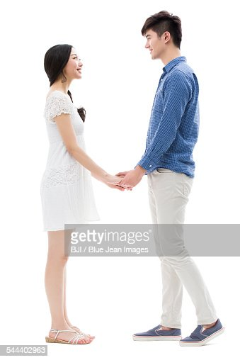 Happy young couple face to face