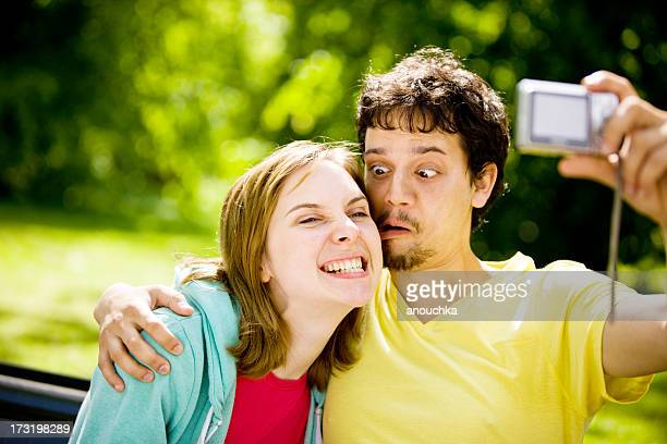 Happy Young Couple Having Fun And Taking Selfie