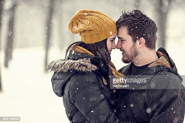 Happy young couple head to head in winter