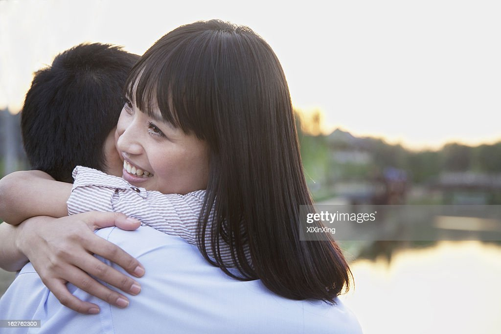 Happy Young Couple Hugging : Stock Photo