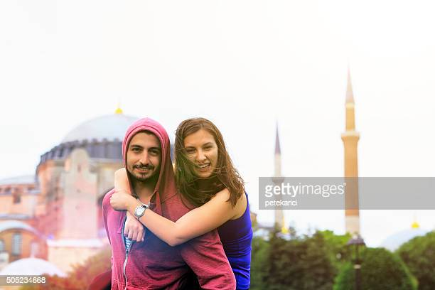Happy young couple in front of Hagia Sophia; Istanbul