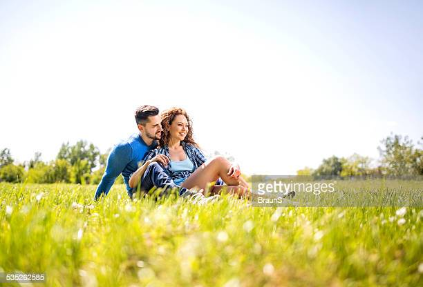 Happy young couple in grass.