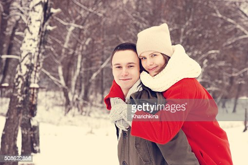 Happy Young Couple in Winter Park having fun. : Stock Photo