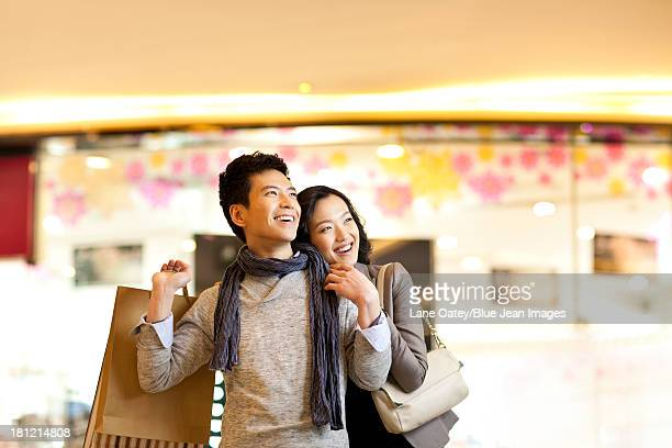 Happy young couple inside of a shopping mall