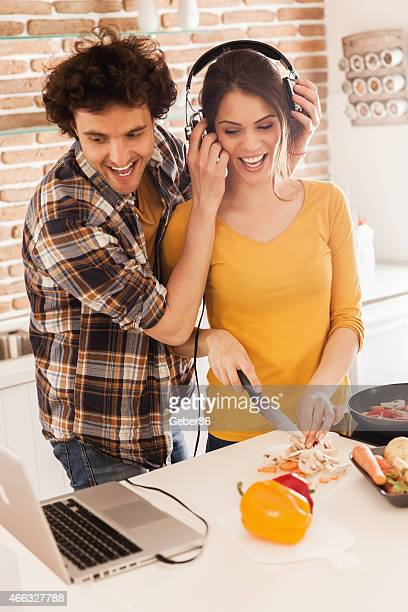Happy young couple listening to music