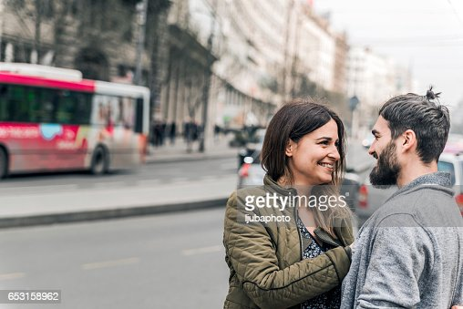 Happy young couple looking at each other on the street : Stockfoto