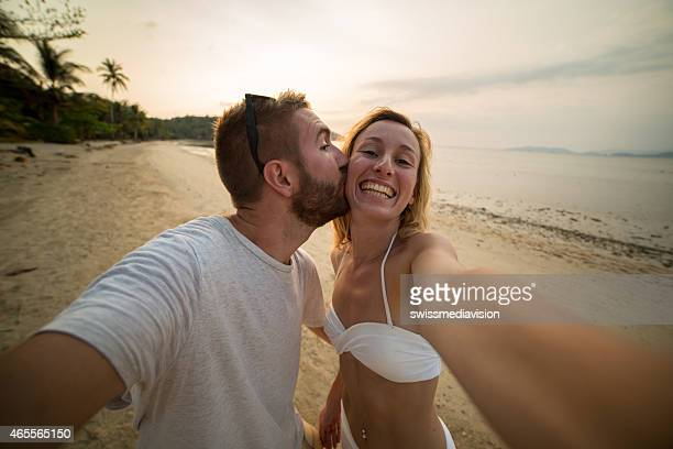 Happy young couple on vacation taking a selfie