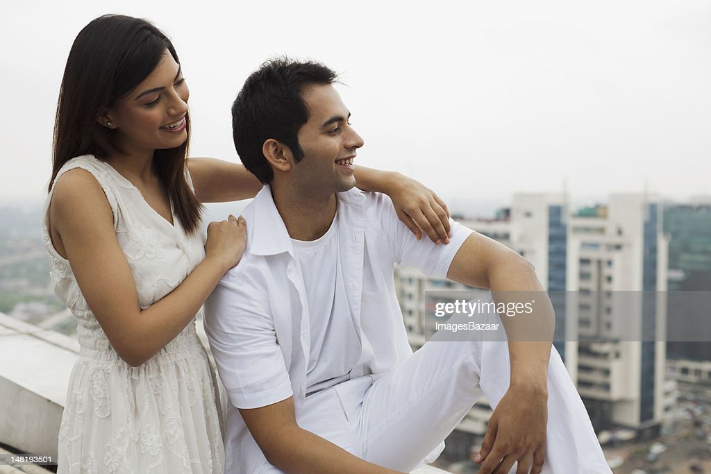 Happy young couple relaxing on balcony : Stock Photo