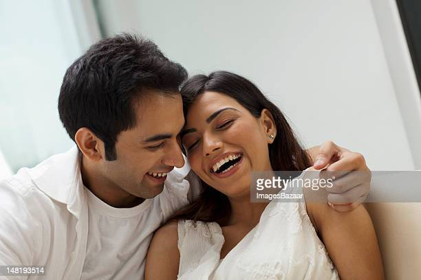 Happy young couple relaxing on sofa