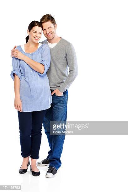 Happy young couple standing together on white