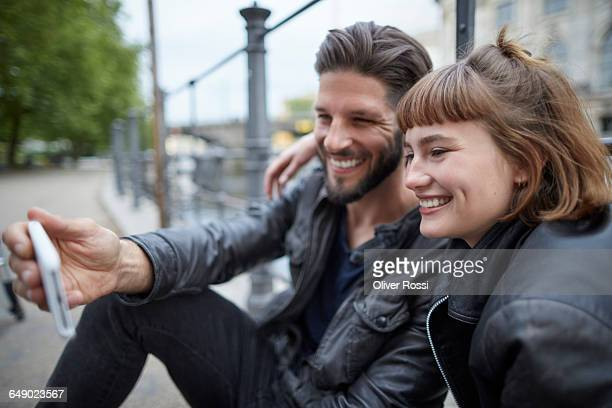 Happy young couple taking a selfie