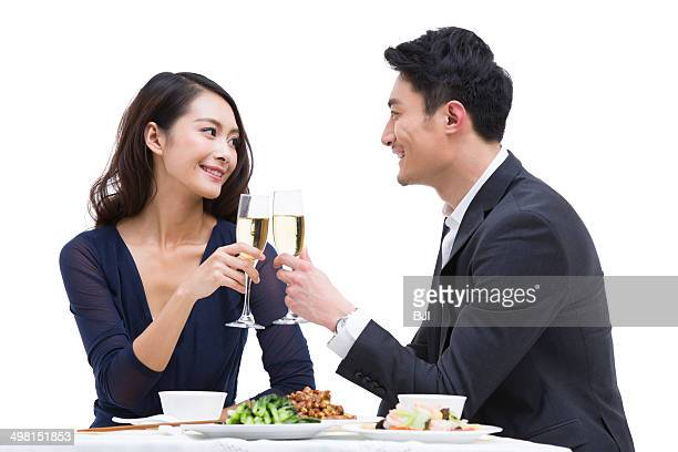 Happy young couple toasting champagne flutes