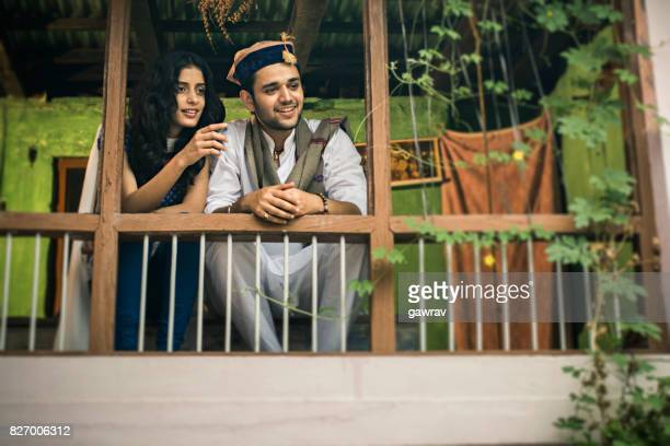 Happy young couple together in balcony.