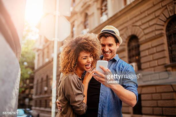Happy young couple using a phone