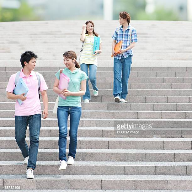 Happy Young Couple Walking On Staircase