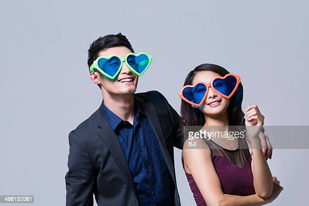 Happy young couple with big sunglasses