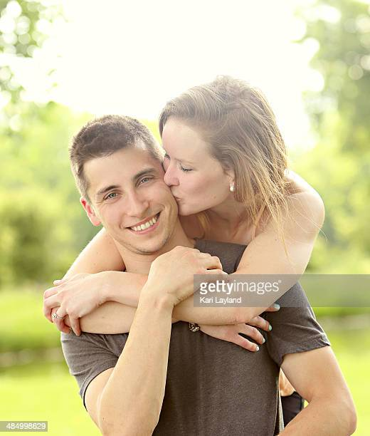 Happy Young Couple - With Kiss