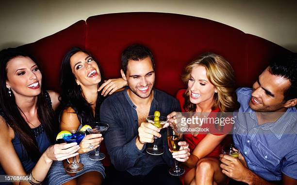 Happy young couples enjoying drinks at a nightclub