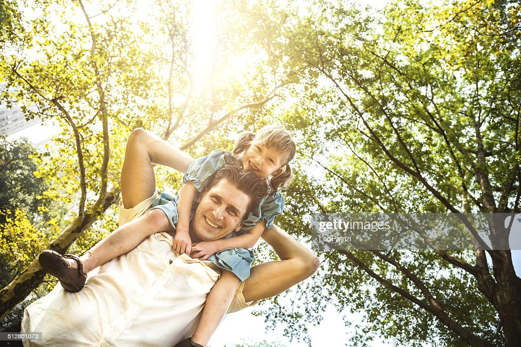 Happy young dad and his daughter