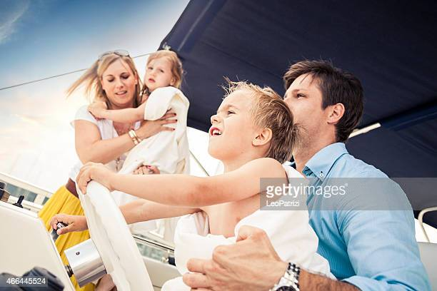 Happy young dad and his son on a luxury boat